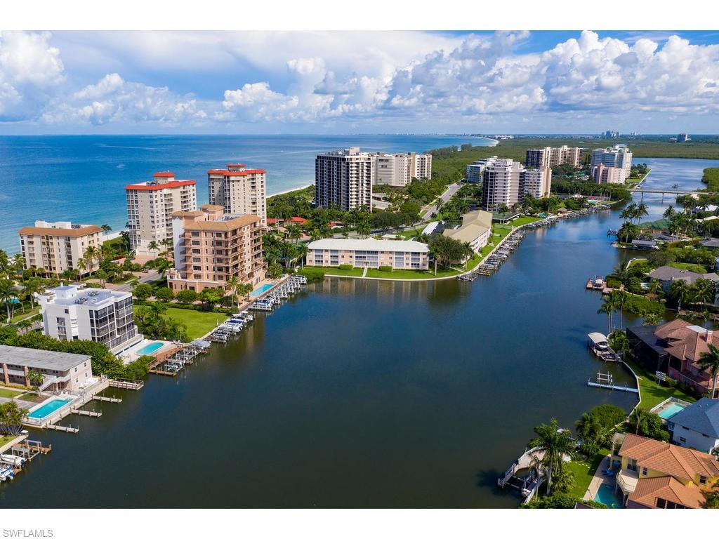 C. 17850 - Deeded boat slip white lift included with purchase of this updated end uint. Completely updated with outstanding bay views and gulf vistas. Beach access directly across the street. Gulf Cove is an intimate condo building with only 9 units total.