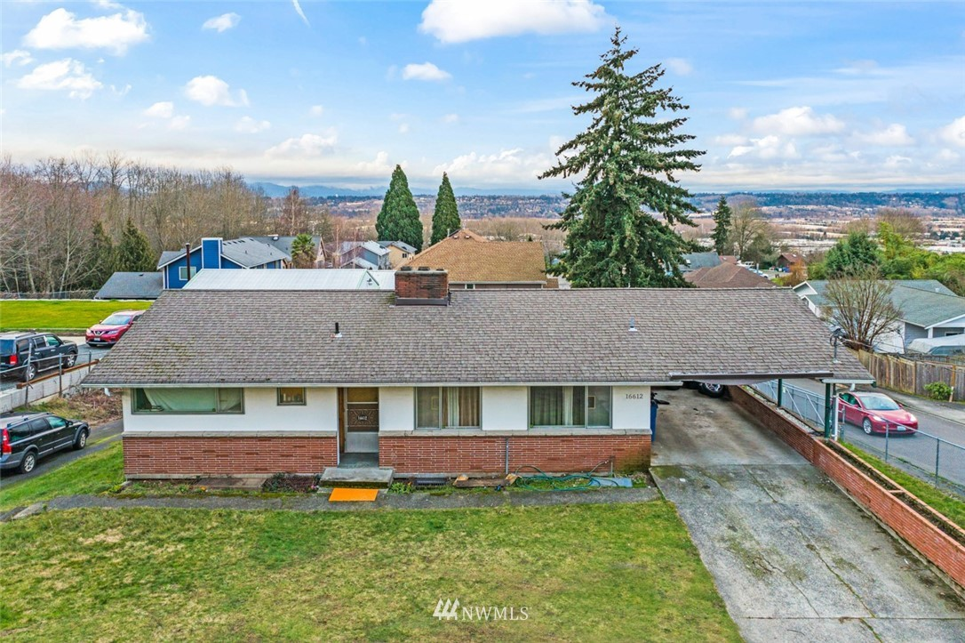 You see the potential -- so do we! Gated entry, shy half acre double lot (sub-dividable -- buyer to verify), residence featuring two levels - both w/separate entryways, apprx 720 sq ft detached garage/shop, workshop w/car lift and engine hoist, addtl covered prkg for vehicles/RV/toys and much more! Central location where lot size and zoning could allow for two bldg sites. Daylight bsmnt rambler makes room for all: Generous living spaces, kitchen has eating space and all applcs stay, two bdrms, full bath on main. Possible second living qtrs on finished lower level w/sep entry, family rm, two bdrms, 3/4 bath. Wired for generator. Driveways, extensive paved areas, fully fenced yard. Quick access to numerous amenities, transit, main commutes.