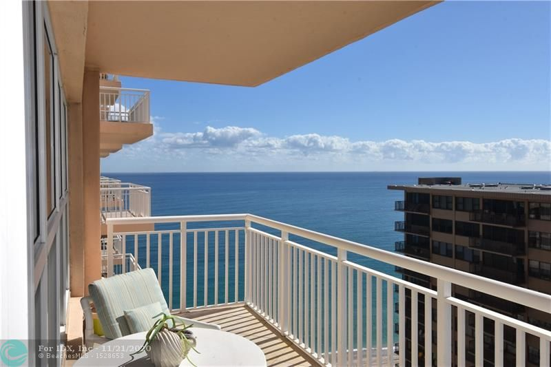 Wait until you see these views!  18th floor sunny south side balcony provides ocean and city views as far as the eye can see; allowing you to watch the cruise ships heading out to sea or boaters ambling down the intracoastal.  When entering the unit you notice the uniform tile floors throughout the high traffic areas while the bedroom offers the comfort of soft carpet to sink your toes in when you wake in the morning.  The open kitchen, with pristine white appliances including a washer and dryer, is perfect for staying connected with family and/or guests while preparing meals.  Decorative fireplace makes the living areas feel warm (pardon the pun).  High speed internet, enhanced cable included.  Storage cage on same floor, parking space 145 included. New A/C unit installed 1/10/19.