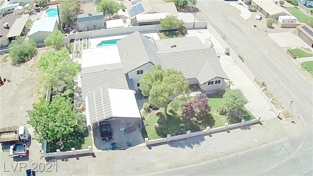 """""""MOTIVATED SELLER"""" """"Recently renovated"""" Great property in a semi-rural quiet neighborhood setting. """"NO HOA"""" Mature landscape, Huge Pool (21'x48'), New carpet in bedrooms, New tile through-out the remainder of the house, Solar panels installed & owned, RV parking & hook-ups, Sports court with lighting, Covered patio/ Open balcony with strip/city views, Garden area, Green house, Up-dated kitchen, Concrete basement/bomb shelter, Added covered parking, Huge laundry room, close to walking/bike trails & dog park, Move in ready."""