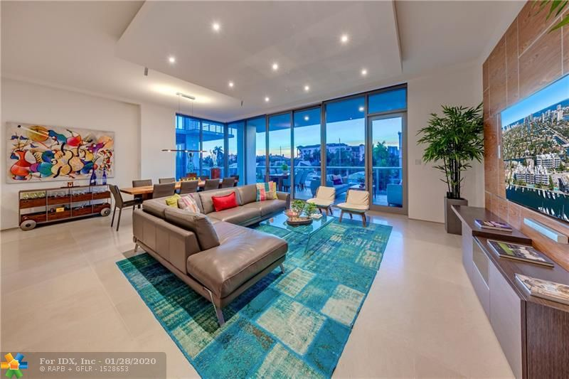 OWN THE ENTIRE FLOOR AT THIS CONTEMPORARY LAS OLAS ISLES LUXURY CONDO! OFFERING OVER 3400 SQ.FT. SPREAD OVER AN OPEN FLOOR PLAN CONDUCIVE FOR TODAY'S LIFESTYLE,THIS UNIT IS COMPLETELY UPGRADED & CUSTOMIZED W/NATURAL STONE FLOORS, SLEEK ITALIKRAFT KITCHEN,WOLF GAS RANGE,SUBZERO & ASKO APPLIANCES.MULTIPLE SLIDING GLASS DOORS INTEGRATE INDOOR & OUTDOOR LIVING SPACES OVERLOOKING THE WATERWAY.4 BEDROOMS & 4.5 BATHROOMS, EACH W/THEIR OWN TERRACES, SPACIOUS CUSTOMIZED CLOSETS, MOTORIZED WINDOW TREATMENTS & CUSTOMIZED LIGHTING.ENJOY THE SUNRISES & SUNSETS FROM THE PRIVATE ROOFTOP TERRACE, W/GAS FIREPLACE,WET BAR,GRILL & HOT TUB.AMENITIES INCLUDE A GATED GARAGE, 2 SPACES, ELECTRIC CAR READY, HEATED POOL W/ CHAISE LOUNGES, & FOB ENTRY SYSTEM. WITHIN WALKING DISTANCE TO LAS OLAS & FORT LAUD. BEACH.