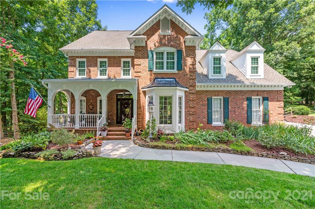 Fantastic all-brick custom built home in the highly-desired Radbourne Neighborhood. Over 80 k in upgrades/updates! Amazing rocking chair front porch on a cul-de-sac offering privacy. Semi-open floor plan, gourmet kitchen w/ stainless steel appliances, gas stove, granite countertops, & tiled back splash.  Open kitchen/family room w/ brick-lined gas fireplace.  Hardwoods on main level.  Master offers two walk-in closets & an amazing renovated bathroom. Huge attic with lots of storage space. Gorgeous crown molding throughout. Picturesque park-like backyard w/ a large deck and magnificent three-season perennial gardens.  In-ground irrigation surrounding the home. Homeowners' Association offers a community clubhouse, in-ground pools, & tennis courts.  If you like nature walking and biking, the neighborhood offers nearby access to the Clark's Creek greenway.  The community is minutes from UNCC, restaurants, shopping centers, with quick access to I-85 & I-77 and 15 min to the light rail.