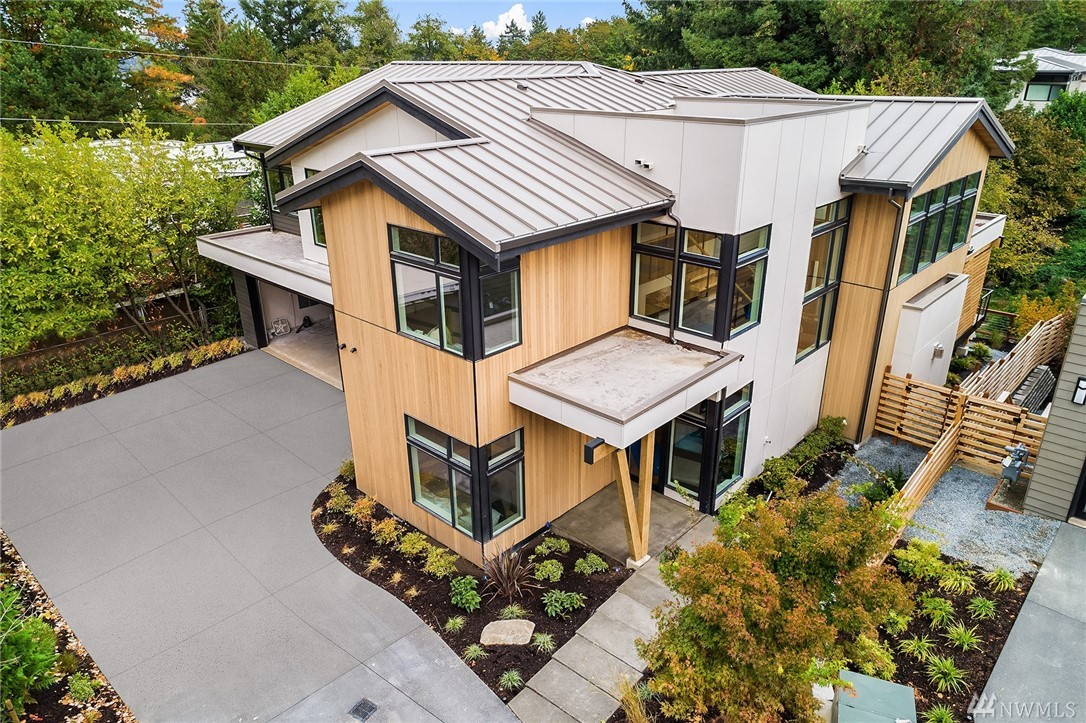 Welcome to Summerwell, Mercer Island's first new neighborhood in almost 30 years! Homesite 10 is nestled into the back of the neighborhood, affording it tremendous privacy. Soaring entry + great room create tremendous volume. Main floor office, huge mud room, gourmet kitchen w/Miele appliances, Poggenpohl cabinetry + walk-in pantry. Hearth room w/FP and lovely covered entertaining deck. Upper level master suite + 3 add'l BRs up + laundry & gallery wall overlooking entry/great room. 3 car garage.