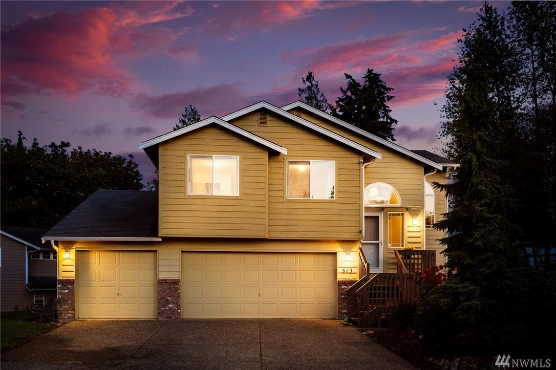 Welcome home! Privacy at the top of the hill. Enjoy the spaciousness of vaulted ceilings, newly updated floors, baths and  deck with hot tub to finish your day. Deck is plumbed w/gas for bbq, sprinkler system for yard with garden space.  Downstairs could easily become a MIL. The 4-car garage/workshop area is the icing on the cake. This won't last long.