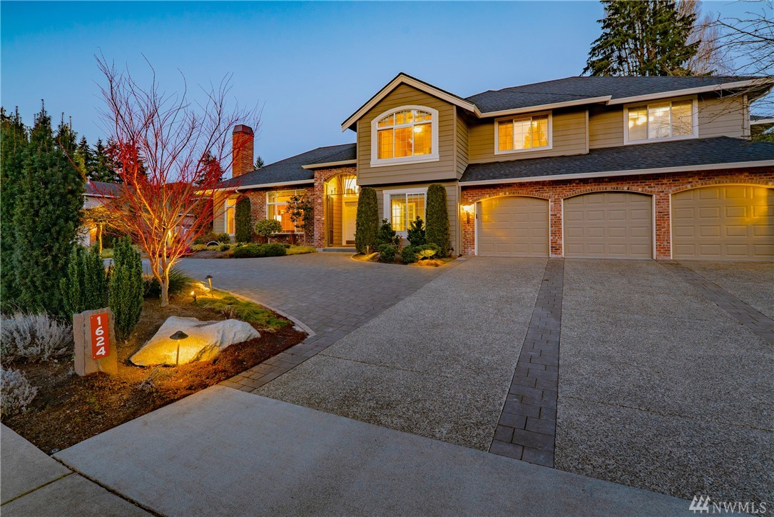 Quiet elegant luxury home with rare elevator access! All the conveniences of Downtown living and just one mile to new Amazon home.  Dual-entrance driveway serves this entertainer's delight with generous gathering spaces. Gourmet kitchen overlooks fully-fenced private backyard with heated patio. High end renovations include stately library and MIL apartment with 2nd kitchen, warmed by radiant heat & gas fireplaces. Pristinely maintained private oasis with solid construction and nearby park.
