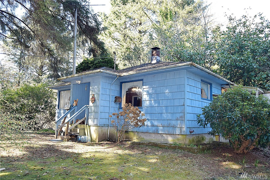 Awesome house set on the hill in Ocean City. Comes with its own well, RV garage, detached garage, and set on two acres. This property is located close to the ocean beaches and is very private. The home has been priced to sell really fast and probably won't last on the market very long. There are big trees on the property that may be harvestable for a profit.
