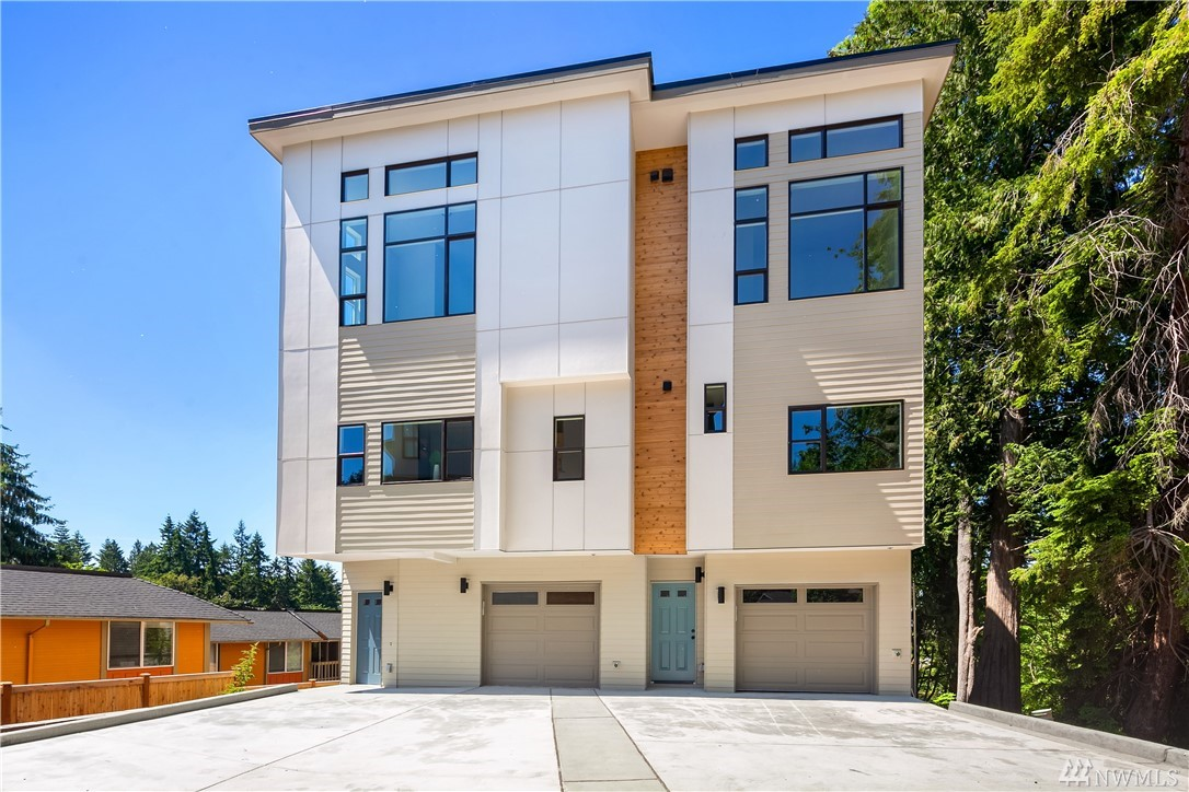 $20k Buyer Bonus!! Redmond Nine's 2,632sqft home offers modern design that backs into greenbelt backdrop w/4 bedrooms & 4.5 baths, dramatic high ceiling master suite w/private surroundings. Spacious basement can be used as 2nd master guest suite/media rm, possibilities are endless!  Each floor has large windows capturing the gorgeous WA sunsets. Situated just above rapidly expanding Downtown Redmond, a short ride from some of the best shopping, dining, and parks on the Eastside
