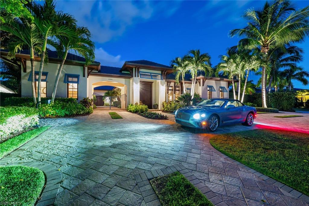 H3621 Stunning gated enclave. Coveted 1/2-acre lot in The Moorings. Exquisite 4-bedroom, den, 4 bath, 1-level, 4400 SF estate. Design elements: wood inlaid ceilings; 14-foot mahogany French doors; Chef's gourmet kitchen boasts French La Cornue oven/range; twin oversized islands; built in Espresso; Subzero; Wolf; Miele; and all expected accoutrements. Glass walls open to outdoor veranda & pool blending indoor and outdoor spaces. Southern exposure. Outdoor space offers secluded park-like setting. Expansive great room features soaring wood inlaid cathedral ceiling accommodating gatherings of family or friends. Luxurious master suite offers a quiet respite. Breakfast kitchen, stunning soaker tub, oversized shower enclosure and massive closet space await. The 2nd master with breakfast bar, unmatched appointments and privacy.  The 2 additional oversized guest suites are En Suite, impressively appointed, and allow for private entry. The residence offers the latest in Smart home technology.  Interior and exterior shades, lights, audio-video, outdoor screens and shutters with touchscreen operation. This one-of-a-kind enclave has never been offered to the market since construction. Every desire met. Ideal location: short walk, bike, or buggy ride to Moorings Beach Park. About a mile to either 5th Ave S. or Venetian Village. See it today. Live it tomorrow!