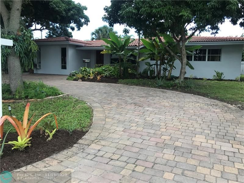 Mid Century Gem ISO TLC. GREAT location, less than 2 miles to the beach, one mile to Wilton Manors, less to the Coral Ridge Mall, half mile to Angelo's Bakery Bar. 3 blocks to Planet Fitness, 4 blocks to The Fresh Market. Absolutely wonderful neighborhood. Very large, Very private back yard. Terrazzo, oak and ceramic flooring. Professional chef's kitchen with granite counters, cherry wood cabinets, 6 burner gas range, convection oven and a large wine closet. Significant solar panels (VERY small electric bills). 2 Cedar lined closets. Easy to show. Call listing agent. Bring your offers.