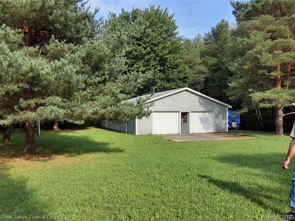 Absolutely beautiful wooded property with a large 32' x 48' Pole Barn with 200 amp electric, an existing well, pond and 30' Skamper Trailer Coach Camper. This is ideal for building your dream home, hunting or just relaxing on the weekends and vacations. Very private and it makes you feel as if you're Up North! It's approximately 8 miles from Lake Huron!