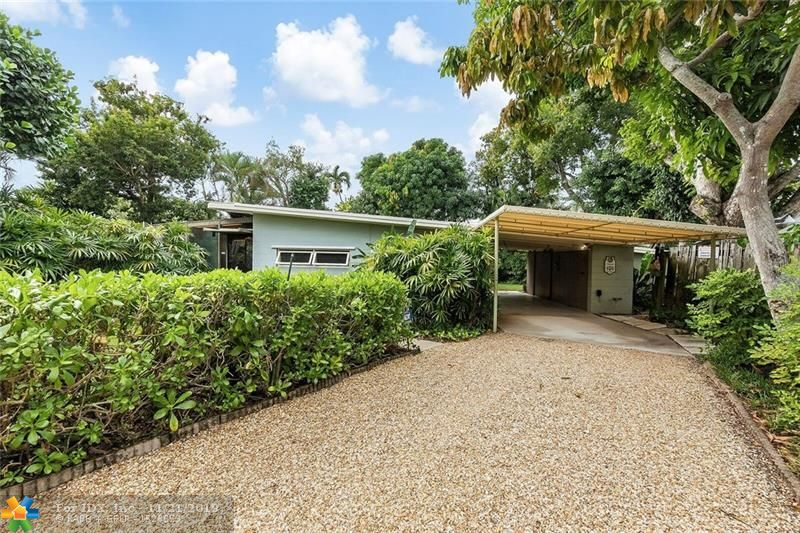 "Rare Mid-Century Gem in the Heart of Poinsettia Heights. Built by renowned Ft Lauderdale architect Bill Bigoney, creator of over 230 Local Homes & Commercial Properties. Strategically Situated & Designed on the 10,000+ sq. ft. lot, to take Full Advantage of the Ocean Breezes. Beautiful Open Concept Floor Plan with All Rooms opening up onto the Lush Tropical Landscaping, Concrete Patio, Pond & Fruit Trees. Amazing Screened-in Lanai, accessible through the Living Room & both Bedrooms via large ""storefront-like"" doors! Both Bathrooms feature Period Tile & Pecky Cypress Walls.  Design Details include:  Vaulted Tongue & Groove Open-Beamed Ceilings, Original Stained Concrete Floors Throughout. Upgraded Electric Service, 2 Car Carport, Extra Storage Room & Storm Shutters. A Definite Must-See."