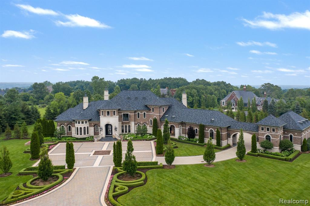 Beyond the gated entrance of Orchard Ridge, this impressive custom estate designed by Tringali & built by Moceri, provides luxurious living. Soaring 20' ceilings, an abundance of natural light characterizes the interiors, w/ beautiful kitchen equipped w/ premium appliances & family room leading out to impressive balcony complete w/ outdoor fireplace. Fine details incl marble & hardwood flooring, walls of windows, curved archways, coffered ceilings & beautiful crown moldings. Accommodations are afforded by 1st flr master suite along w/ 3-bedroom en-suites w/ WICs. Thoughtfully designed to meet more contemporary needs from the temperature-controlled wine cellar to the home theater & elevator access to all 3 floors. Walkout LL features full bar, family room, workout rm & multiple rec/play areas. Exterior features incl swimming pool, large brick paved patio, 6 car garage & manicured lawns. This prestigious home is ideal for hosting gatherings of friends & family on any scale.