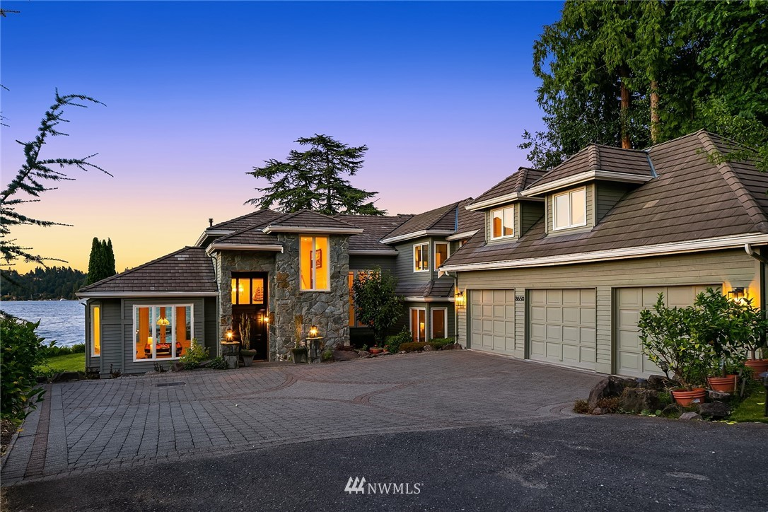 Superb Northend Traditional w/70' of private no bank waterfront to enjoy all the indulgences of refined lakefront living. Take your docked boat out for an early morning drive to enjoy the misty calm waters of Lake WA. Delight in the marvel of an eagle slowly gliding by. This home offers traditional spaces for separation, a den on the main, w/a large open kitchen & dining for great entertainment options. Relax on your view deck & watch friends play football, or badminton, or race away on their Seadoos. Enjoy the firepit at waters edge. Walk to dt Mercer Island to enjoy  eateries, cafes, & shopping. Truly the best of all worlds, private nature surrounds in the midst of walkable conveniences nearby & amazing proximity to Seattle & Bellevue.