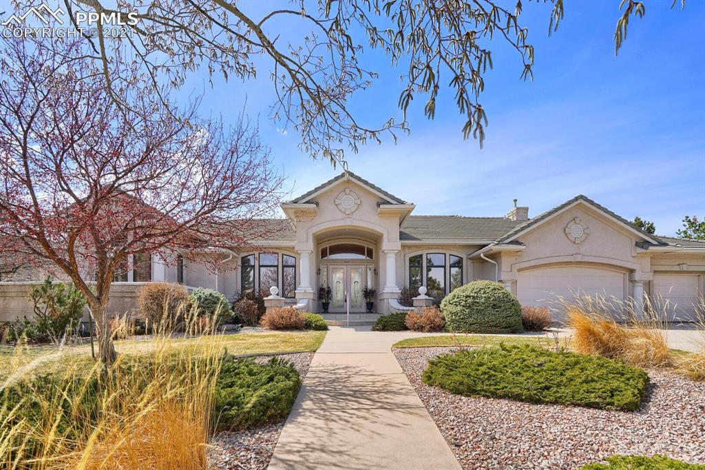 "One level living on the Golf Course with spectacular views of Pikes Peak, Garden of the Gods and the Front Range!  3 bedroom suites plus an office/study are all on the main level.  With grand windows throughout the home, the large living room features extraordinary ceiling detailing for architectural interest, a spectacular mantle and fireplace surround with 2 walkouts to the terrace patio. The master bedroom suite has a sitting area with a fireplace to enjoy the view, his/hers baths and his/hers closets. The kitchen is open to the informal dining area and hearth room with a walkout to the back patio for easy entertaining. The large formal dining room will provide great opportunities for entertaining family and friends. 8' doors and soaring ceilings make a grand presence. A 3-car garage offers parking and storage.  Property is in an estate, being ""Sold As Is""."