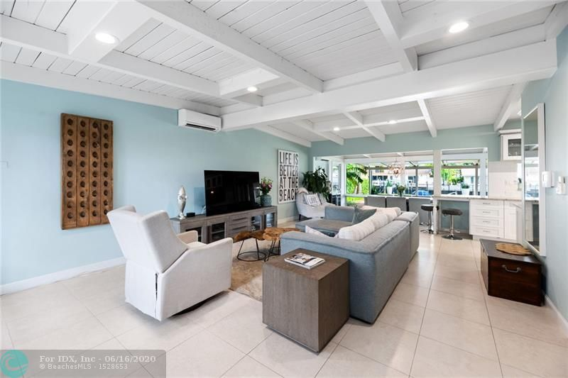 OVER SIZED BACK YARD. LARGE SALT WATER POOL. IMPACT DOORS, UPDATED KITCHEN AND BATHROOMS. PRIVATE BEACH, GREAT VACATION RENTAL HOME AS WELL. GREAT BEACH COTTAGE. THIS IS A MUST SEE!