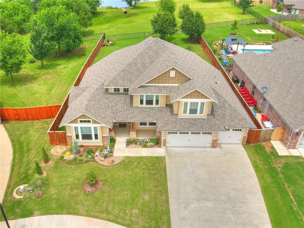 """Nearly-new, lakefront Craftsman-style home built by Genesis Fine Homes in 2017; One owner, 4 bedrooms, two full-baths and two half-baths; 2 living areas, gourmet kitchen, study, three-car garage with below-ground storm shelter. First floor has 2,241 square feet with front and rear covered porches. Lots of light. Second floor includes approximately 1,200 square feet with covered balcony overlooking private, 9-acre lake. Bonus room with wet bar opens to large lakeview balcony; Bedrooms equipped and ready for cable/dish hookups and electric outlets in wall for mounted TVs. Low-e windows with """"Solar Guard."""" 8-inch Craftsman style squared base moldings and full casement on interior window trim. Alarm system. Custom metal fence on lakefront, custom blinds (downstairs motorized) from Morren's, landscaping from Marcum's. Seller will provide home warranty on appliances."""