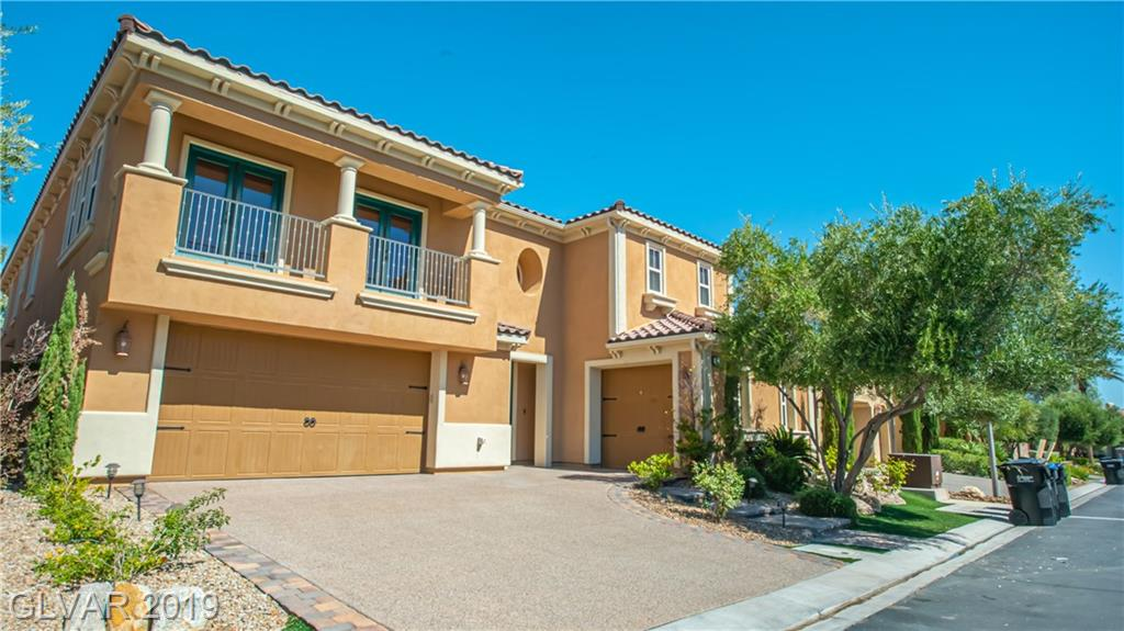 Absolutely stunning 4 BD/4.5 BA Home Located in gated Bella Fiore in the heart of Lake Las Vegas*Upgraded including stone and wood flooring, granite counters, stainless steel appliance in kitchen, marble bath & custom window treatments. Balcony off master bedroom. Inviting backyard with beautiful pool & spa. Covered patio with pavers and lush landscaping. Many more features not mentioned*This home is a must see!
