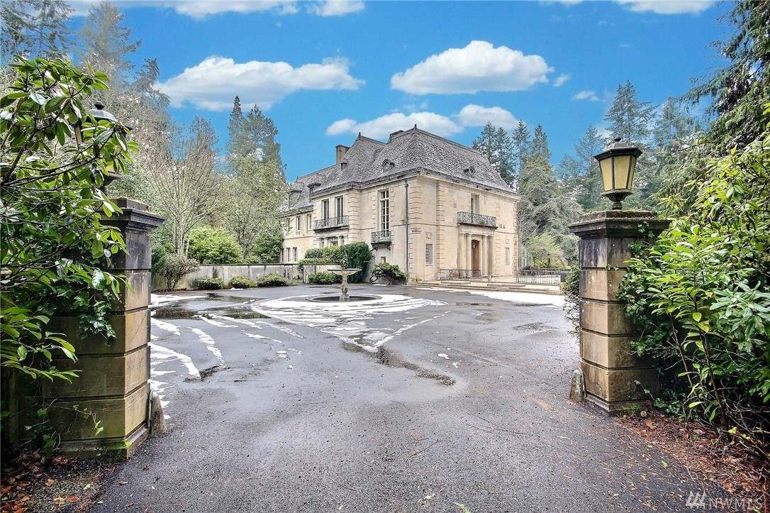 Historically significant French Chateau home in exclusive gated community The Highlands! Previously custom home for D.E. Frederick, owner of Frederick & Nelson, designed by famous architect Lewis P. Hobert. 100% concrete structure, Florentine marble staircase, 25' ceilings, antique wrought iron railing. The entire Venetian room came from an old Italian castle of the 1800's. Antique original oriental paintings in dining room, original crystal chandeliers, Otis elevator, Olmsted designed gardens.