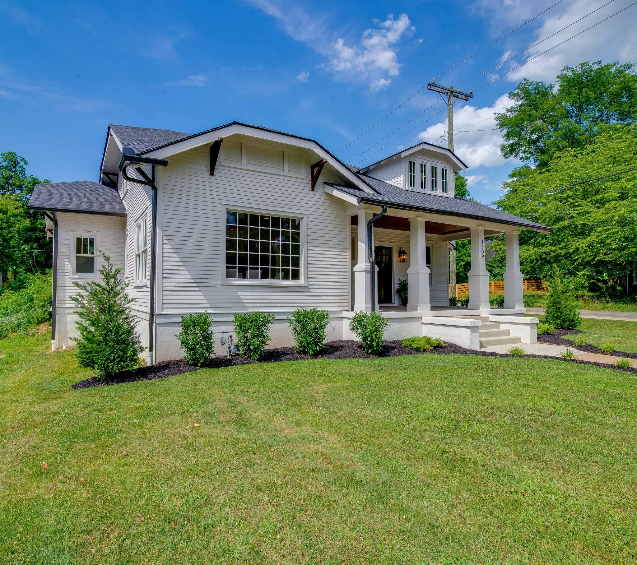 Historic meets Modern!!! Nothing untouched on this renovated historic bungalow in Lockeland Springs on Edgewood Place, the best kept secret in E. Nashville! Tons of character brought back to life... original doors, trim, hardware, coffered ceilings, wainscoting, butler's pantry, brick fireplace, clawfoot tub, & hardwood have been revitalized in this timeless showplace! Professionally designed! Expansion area in basement! Huge corner lot with endless possibilities... DADU approved!!! Owner/Agent