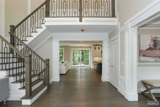 Tenafly gorgeous new construction featuring approx. 6000 sf (with finished basement). Central hall colonial with 6 bedrooms and 6 bathrooms situated on a beautiful lot. High ceilings, high end finishes all around The first floor consists of 2 story entrance foyer open to formal living room & formal dining room leading to huge modern eat-in kitchen with top  appliances, pantry room, butler pantry, over-sized island open to spacious  great room overlooking private backyard, full bath and bedroom/office on the first floor.  A huge mudroom connected to a 2 car garage.  2nd floor features a master bedroom suite with his/hers walk-in closets, one bedroom suite,2 bedrooms and a j& j bath, a laundry room and linen closet.  The lower level has a bedroom,rec rm , gym, fb,media rm .  Lot can accomodate a pool for additional cost.