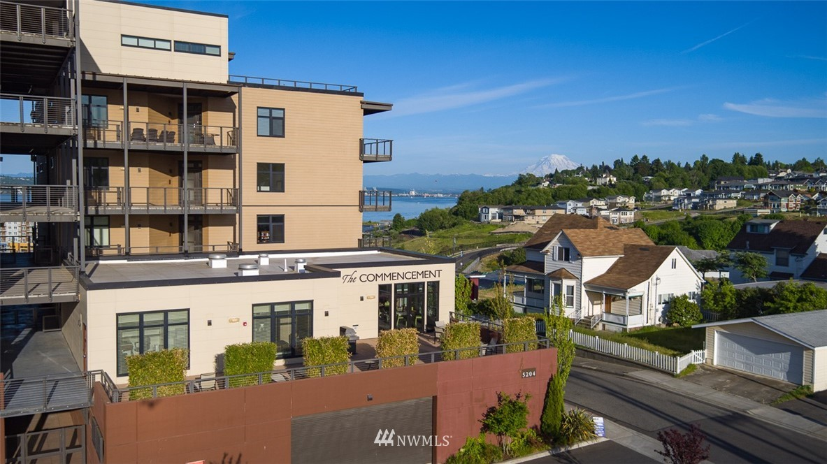 Ground floor unit boasting 2,045 Sq ft, atop Ruston Way's incredible renovation, offers lovely views of the Sound & Mt. Rainier! Spacious deck, Open floor plan, Den, SS appliances, gas cooktop, floor to ceiling Euroline windows, built-ins & a knock-out Master Suite. 2 designated parking spaces+storage. Exercise room & Club House. Walk to Pt. Defiance, Dune Park, restaurants, shopping and so much more!The Commencement has it all.