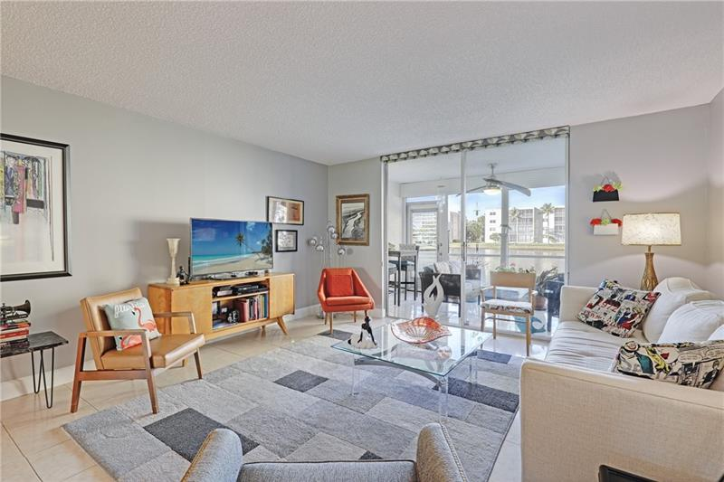 Large remodeled 2/2 with a mid-century modern vibe. Furniture is available to purchase. Lots of storage with 3 closets in primary bedroom, 4th closet with WASHER DRYER hook-up, linen closets, foyer closet, large walk-in closet. Updated: AC, hot water tank, electrical panel, 1 year old IMPACT WINDOWS. Assigned parking space, plenty of guest parking for a 2nd car. Quiet area, building passed 40-year inspection. Roof completed in Feb 2021, special assessment paid. LOW HOA fee, professional management company, security cameras, a beautifully remodeled clubhouse with great activities and gatherings including Thursday night Happy Hour, a new gas grill, heated pool, walking distance to Nature Center and Westlake Park, 1 mile to Hollywood Beach. Walk to stores, restaurants, bakeries, and cafes.