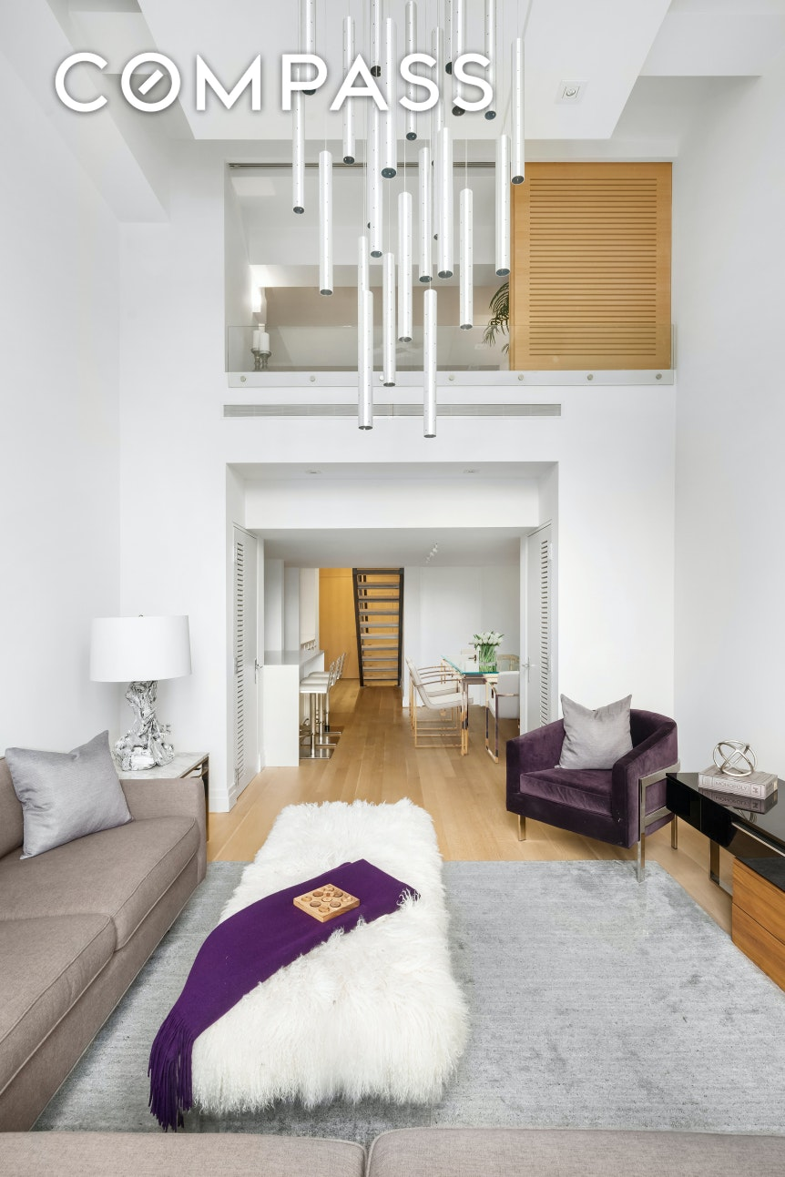 Contact us for a VIDEO walkthrough.Stunning and spacious one-bedroom, two-bathroom West Village apartment at the iconic Printing House condominium! This impeccably-designed, 950 sq ft loft-like home is a modern beauty graced by elegant white oak cerused wood flooring, 15-ft ceilings in the double-height living room, 9-ft east-facing double-paned windows that optimize natural light, and a striking oak staircase with blackened steel handrail ascending to the mezzanine.Greeting your entry is a gracious foyer, off of which sits a finely appointed full bath. Beyond is the oak staircase to the master suite, a generous walk-in closet with Bosch washer-dryer, open-concept kitchen and dining space, plus a dramatic living room with soaring ceilings and city views. The gorgeous white kitchen adorned with Caesarstone countertops, glazed terra cotta tile backsplash, matte lacquer custom-designed millwork/cabinetry, and large counter with seating is a contemporary work of art. Top-of-the-line Bosch, Wolf and Sub-Zero appliances are at the chef's disposal to inspire culinary creations.The peaceful master bedroom perched on the mezzanine level overlooks the living space and is brightened by the same tall windows. This unique retreat features 2 big closets, a sizable storage area, and limestone-clad en-suite spa bath with marble accent walls and Dornbracht polished chrome. Other highlights include prewiring for cable, high-speed Ethernet, and a home automation control system.Built in 1890 and anchoring the West Village, the handsome, historic Italian Renaissance Palazzo-style Printing House was completely reinvented by the innovative design firm Workshop APD, melding its industrial heritage with a contemporary flair. The 60 new condo residences are enhanced by the luxuries of a full-time doorman, live-in super, concierge services by Abigail Michaels, newly-landscaped private mews, onsite laundry, valet service, access to Equinox within the building complete with a rooftop deck and p