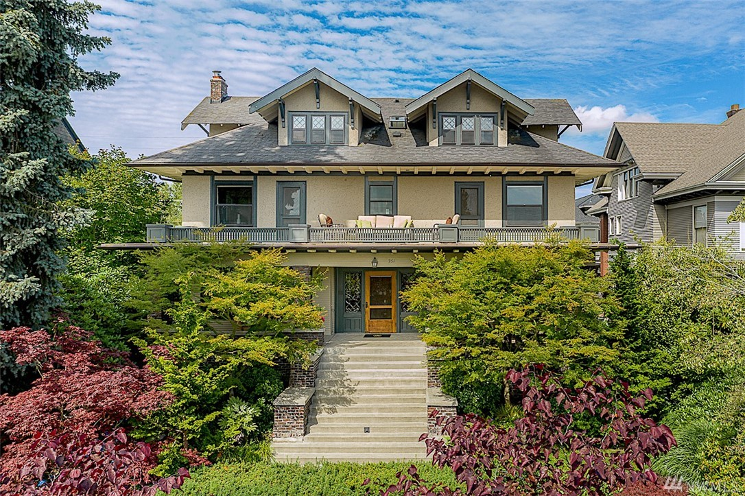Majestic Four-square Craftsman in one of Seattle's most coveted neighborhoods. Lake, mountain & city views from grand and gracious spaces flooded with natural light and filled with beautiful Arts & Crafts details. A splendid Traditional home, embraced and significantly enhanced by the current owners. Numerous improvements undertaken to heighten the beauty of her bygone era and modernize for today's living. Enveloped by lush, mature gardens, a timeless classic with once-in-a-lifetime appeal.