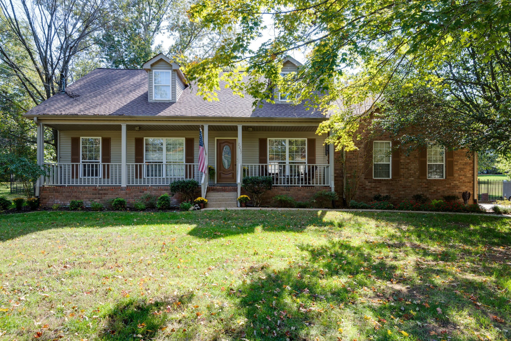 """Renovated! 3060 Sq Ft.(Prior Appraisal)4 BR's 3 Full BA's W/2 BR's & 2 Full BA's Main Level! Beautiful Acacia HW Floor & Ceramic Thru- Out Main. Masonry WB FP In LR. Island Kit W/Granite &  SS Samsung Appl. Eat in Kit. & Dining Area W/Col """"Open Concept Floorplan"""" Perfect For Entertaining Leads To Lg Patio. Media Rm./Home Office W/Priv -Teen-In-Law Suite 2 BR's & 3rd Full BA & Game RM. Walk In Attic W/Storage- Oversized 2 Car Side Entry Gar. W/Work Area Full """"Iron""""  Fenced Bk Yard Cov Front Porch"""