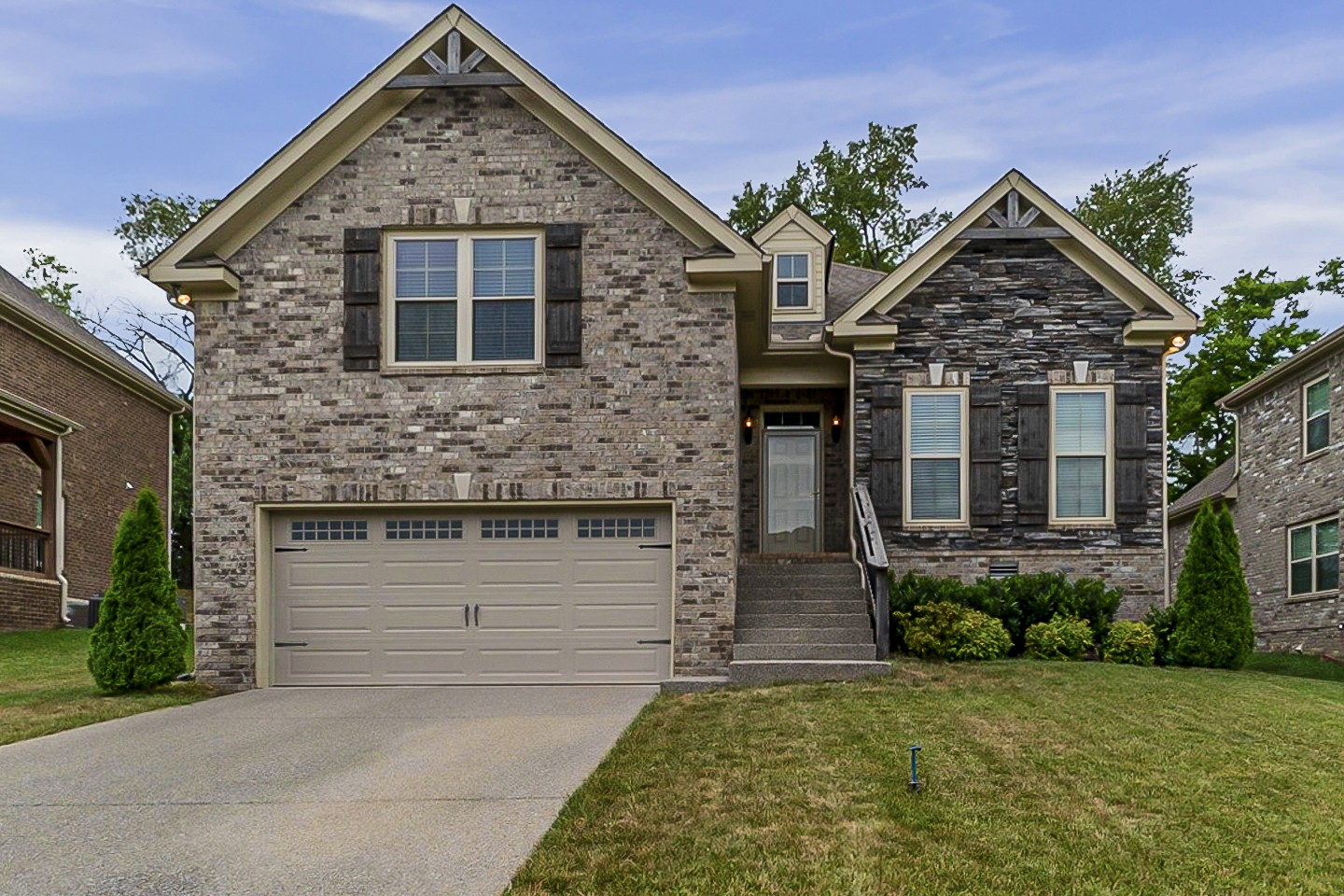 Built in 2017, this Spring Hill one-story home offers granite countertops, and a two-car garage.