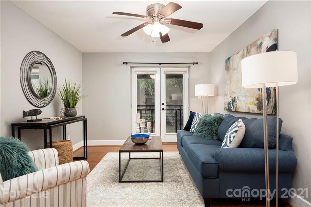 **All offers due by noon Monday, July 12th.**  Rare opportunity to purchase a large 2 bedroom, 2 full bath condominium at The Grove in the heart of Elizabeth. Very private second-floor location with tree views from every window. As an end unit, it has natural light on three sides, with wonderful morning exposure in the kitchen and dining area. French doors from living area to covered balcony perfect for morning coffee under the mature tree canopy. Recent updates include HVAC replacement (2020), new carpet (2021), and engineered wood flooring in kitchen, living area and hall (2017). Separate laundry room with full-size stackable units included. Beautiful community pool and clubhouse with fitness center and rooftop terrace. Super convenient to Uptown and Midwood entertainment, and just a short stroll to Laurel Market or the Briar Creek Greenway at the Mint Museum. Come take a look!