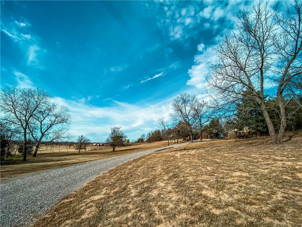 Don't this beautiful and well loved family home with tons of potential and the most amazing views AND a pond! This house has so much to offer with the opportunity to make it your very own with just a few updates. 4.44 MOL acres and all the privacy you could possibly want, while still being very close access of I-35 and I-44, within a few short minutes! With a detached two car garage with extra living space/office area, this could even work as a guest house! You have to see this for yourself to envision what this unique property could be for YOU!