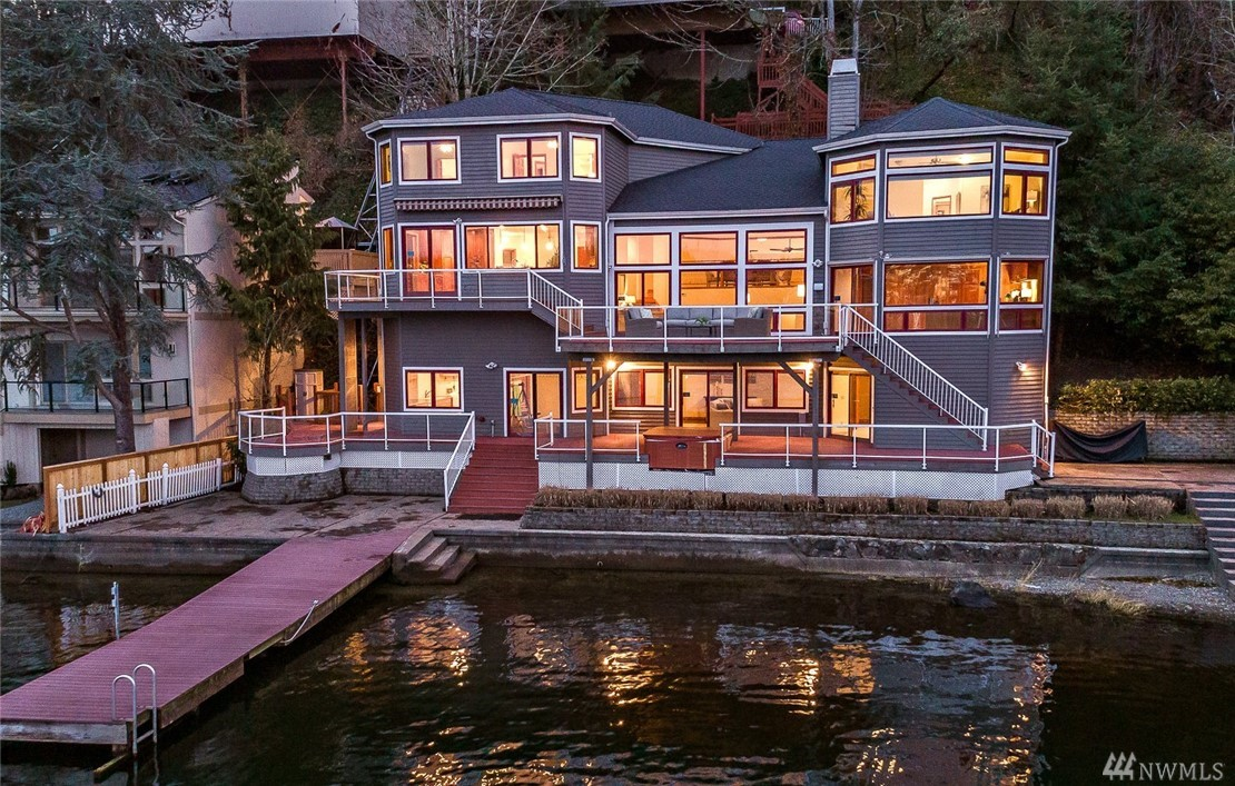 Positioned on the water's edge, enjoy all that lake living has to offer! This  iconic NW contemporary has soaring walls of windows allowing the sun to stream in while you watch all the activity on the lake.  Mountain views as well! Lake Samm address but on quiet Mallard Lane. 105 ft of waterfront. The three levels have been tastefully updated and feature a cook's kitchen w/a large island, granite counters, custom cabinetry & stainless appliances.  Three entertaining decks, hot tub & large dock.