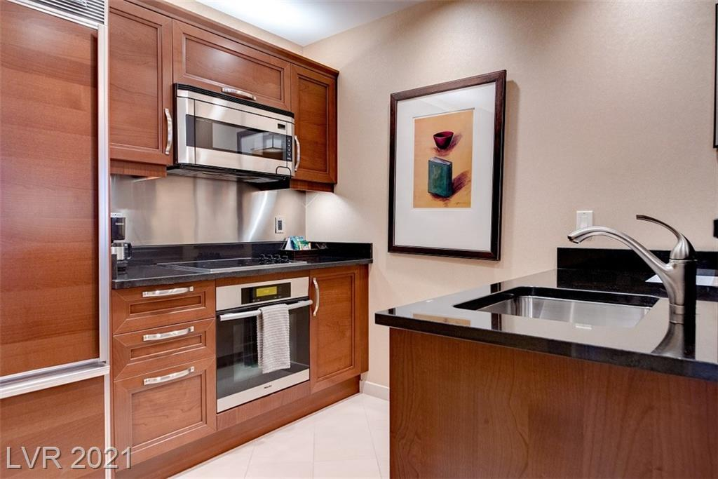 Two units being sold together as conjoining 2 Bedroom. Units can be rented by Owner or in 3rd party management program. Currently being rented by StripViewSuites. Studio 520 sqft HOA $674.38/monthly, annual tax $1991.14 One-bedroom 847sq ft HOA $1348.76/monthly, annual tax $2915.96