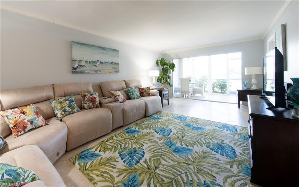 Beautiful remodeled first floor condo in the Moorings with pool and lake view. This nicely updated unit features impact windows and doors. The kitchen has been remodeled with stainless steel appliances, new cabinets and granite countertops. Both bathrooms have been remodeled. This home is located West of 41, close to Olde Naples, beaches, shopping and restaurants. Walk out the back of the unit to relax by the pool.