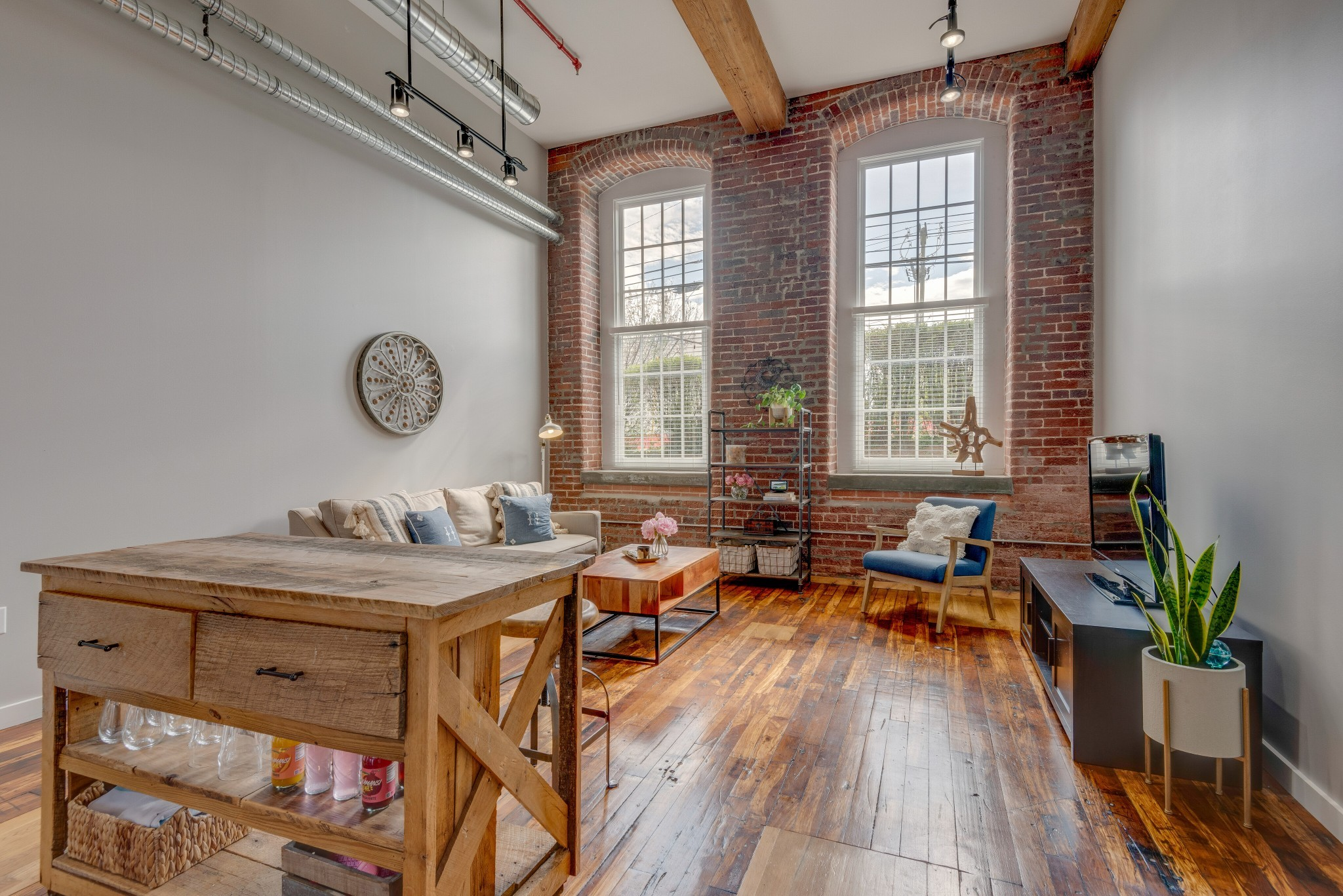 Updated + stunning residence in Historic Germantown's Werthan Lofts, with convenient proximity to the pool & building entrance. Home features soaring ceilings that maximize the natural light, exposed brick & original hardwoods. Updated bathroom w/ new vanity, updated lighting throughout, custom pantry door, granite countertops, new tile backsplash, & custom wood island. Werthan Lofts has 2 pools, fitness/yoga spaces, + gated parking. The perfect location for restaurants, shopping, entertainment!