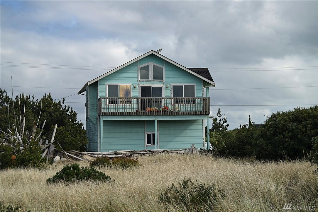 Beautiful home with a great ocean view just a block from the beach in wonderful Ocean Shores, Washington. This architechtually stylish home is a one bedroom with a giant garage that could possibly be made into more living space. It also has an ocean view balcony and fireplace. The owner loves to collect treasures found on the beach and had has left lots of driftwood and buoys behind. This home is ready for a new owner to move in and turn into their own.