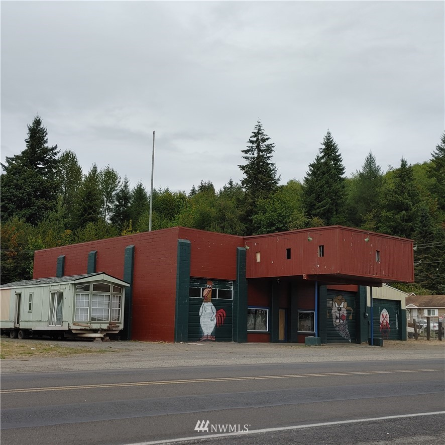 In the heart of Mossyrock you will find this light industrial shop with lots of potential on 1.4 acres.  (2) 14 foot garage doors. (1) 10 foot garage door. There is a hydraulic auto lift, big heavy equipment machines, commercial metal lathe. The building was built in 1920, total sqft. is 4270. There is a nicely remodeled home on the property. The shop yard is full of miscellaneous items some items will be included in sale.  Ideal property for a mechanic. State street is on the front side of the property. Main street is on the back side of property great location. Property is fenced.