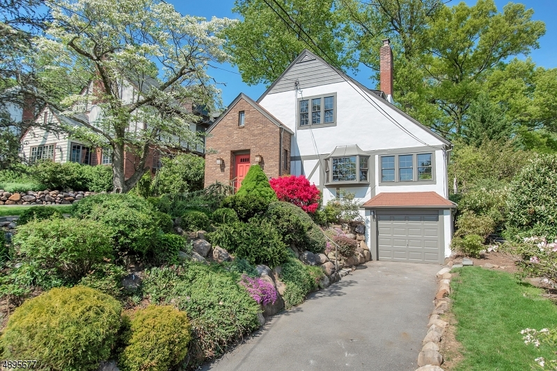 Welcome home to this charming 3BR, 2.1 BA Tudor. Foyer w/slate tiles, wood burning fireplace in LR, bay windows w/partial city views. Eat-in kitchen w/breakfast nook & formal D/R. SS appliances & granite countertops. Lower level recreation room. 3 lge B/R and 1 full BA complete the 2nd FL. Custom landscaping & lush bkyd perfect for outdoor entertaining. Bkyd oasis features a stone patio, fire pit & garden. Ideally located within easy access to downtown Millburn and Maplewood Village. One block from Wyoming Elementary School. 1 mile to NJ Transit Midtown Direct train to NYC and near all major highways. Close to Newark Liberty International Airport.