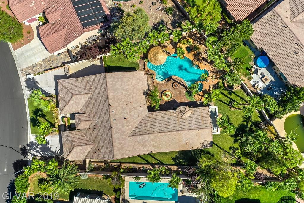 ONE OF A KIND~Spectacular Entertainers Dream Home~One Story~Appr 3,582 SqFt, 4 Bed + Den,4 1/2 Bath (Includes a Private GUEST HOUSE with Full Kitchen,Living, Bed & Bath) AMAZING Private Backyard Oasis~Pool, Spa, Grotto, Waterfall, Misting System, Palapa Bar, 28'x22' Cover Patio, Gourmet Outdoor Kitchen Area w/Built-in BBQ~3 Car Garage+Side Gated Parking~Spacious Floorplan~Monogram Appliances~Plantation Shutters~Coffered Ceilings~Gated Community!