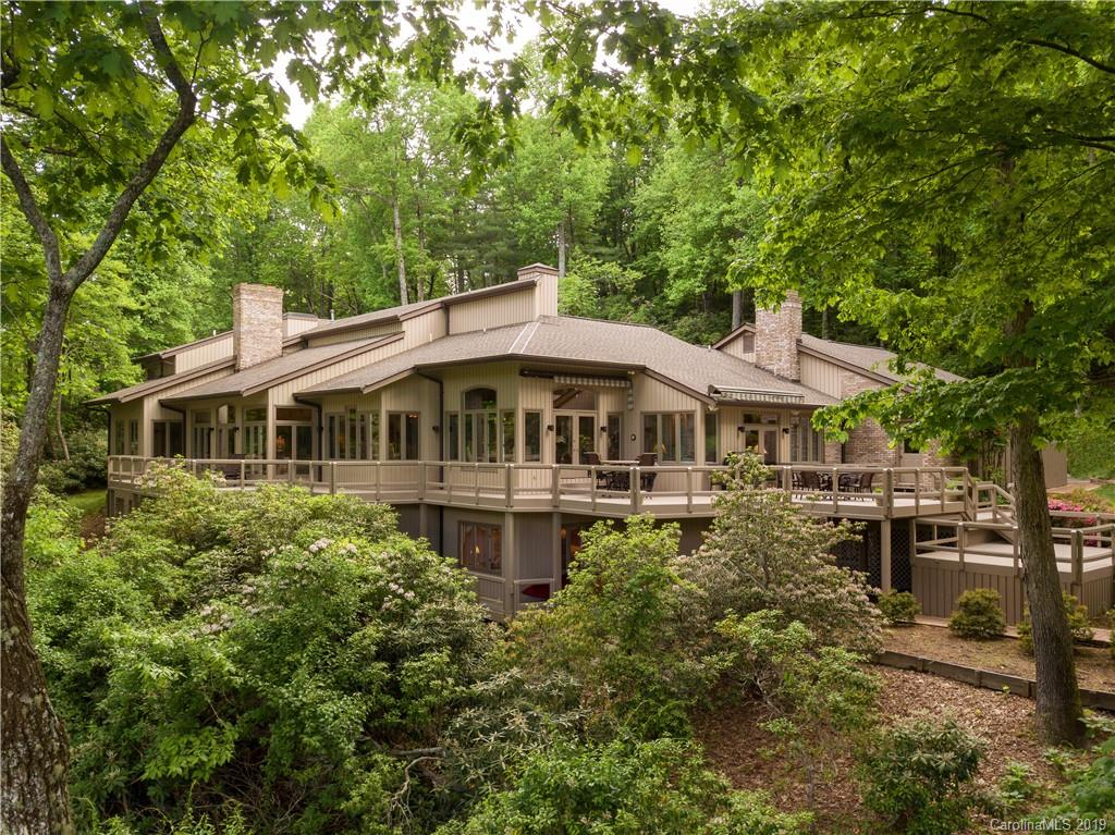 Fantastic location, setting, views and architecture. Exceptional quality, elegant yet comfortable describes this well appointed Kenmure classic that will never go out of style. Main level has large off set windows that take in the view from every room. Inviting entry with sunken great room,office/study,wet bar,gourmet kitchen with keeping room and soaring tongue and groove ceilings,informal and formal dining, master suite and private luxurious master bath surrounded by glass exterior walls. Open and covered decks to entertain guests and admire the view of the signature 17th fairway. Lower level has family/game room, full kitchen and bath,office,fitness/flex room and media room. Upper level has two bedrooms with a Jack and Jill bathroom. This home is in walking distance to the indoor/outdoor pools/fitness and tennis. Agent on-site to accompany showing or give amenity tour.