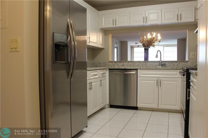Newly remodeled first floor unit with wide canal views over 1200 Sq'. Your new eat-in kitchen boasts new granite counter tops, double sink, newer cabinets, & new SS appliances. The dining area also features a breakfast bar just add stools. This unit design has a large living room and a bonus room that overlooks the canal. The bonus room could be used as a Den/Office/3rd Bedroom. Your master bedroom comes with water views and dazzling new bathroom. Unit features its own laundry room with washer/dryer and storage. This unit has plenty of storage and the club house deed has been paid in full. Your parking spot E102 is located just outside your front door. Kings point has top notch amenities including; Transportation, indoor & outdoor pools, theater, activities, tennis. No rental restrictions