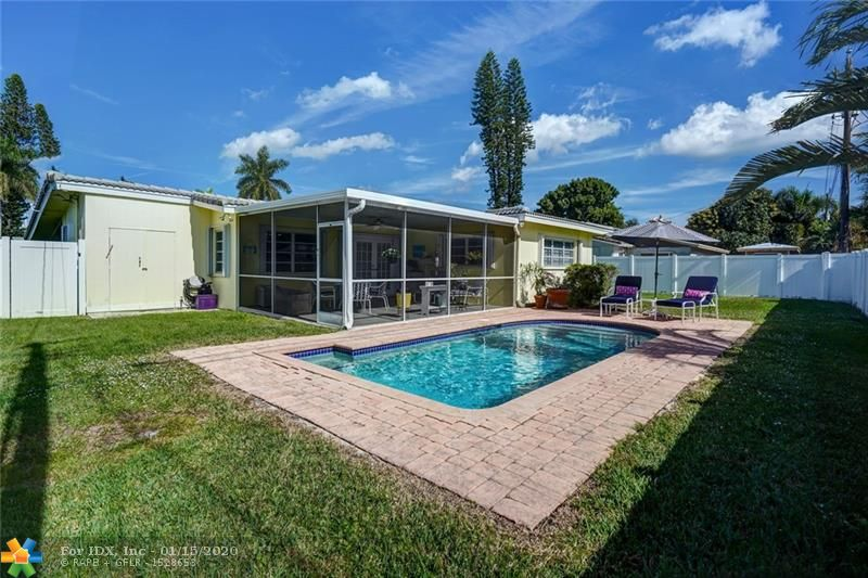 A CHARMING PARADISE IN THE HEART OF THE COVE!  THIS WELL CARED FOR HOME OFFERS TWO LARGE BEDROOMS AND TWO BATHS. MASTER BEDROOM HAS EN SUITE BATH AND LARGE WALK IN CLOSET. FRENCH DOORS FROM LIVING AREA OPEN TO LARGE OUTDOOR LIVING PORCH WITH LOVELY VIEW OF PAVER PATIO AND POOL. VERY LARGE KITCHEN WITH DINING AREA, GRANITE COUNTERTOPS, AND STAINLESS APPLIANCES. DREAM LAUNDRY ROOM OFF KITCHEN IS ALSO ACCESSED FROM CARPORT.  HUGE FENCED YARD, LARGE CIRCULAR DRIVE, ADDITIONAL OUTDOOR STORAGE, ACCORDION HURRICANE SHUTTERS,  EAST OF  12TH AVE, IN THE HEART OF THE COVE!