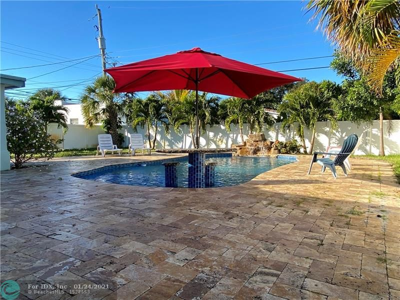 Spectacular freshy renovated 4 bed 4 bath pool home in Wilton Manors. Newer Bahama tile roof, AC, fencing, pavered driveway etc. 3 bedrooms feature private entrances from the pool area. Renovated kitchen with new appliances and 4 renovated baths. Separate laundry room with new appliances. Double master split layout lends to privacy and easy mother-in-law or partial rental usage. Open floorplan provides for maximum versatility. Large lot with spacious private backyard makes for the perfect South Florida oasis. Close to highways and all amenities this one should not be missed. Easy to see!