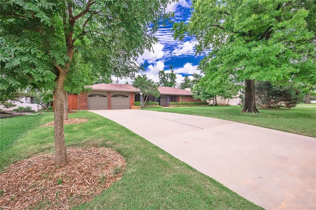 PRICE REDUCED - BEST VALUE!!   Charming RANCH style home on a quiet Nichols Hills street-Wide lot (99 X 156) .35 acre Spacious and well maintained!  2 large living rooms with lots of natural light and a big stone fireplace-Newer windows too!  Karen Black designed and remodeled the kitchen (Kitchen-aid appliances) and 2 of the bathrooms!!   Beautiful walnut floors (living, entry and hallway) parquet wood (den and 1 bedroom)  You will love spending time outdoors in the backyard- the covered space has a wood burning fireplace and TV hook-up. (Plenty of room for a pool or an addition)  4th bed is MIL plan - perfect for an older child or a home office. Move in Ready or priced to make changes!  Don't miss seeing this house you will love it!  Perfect for Everyone!