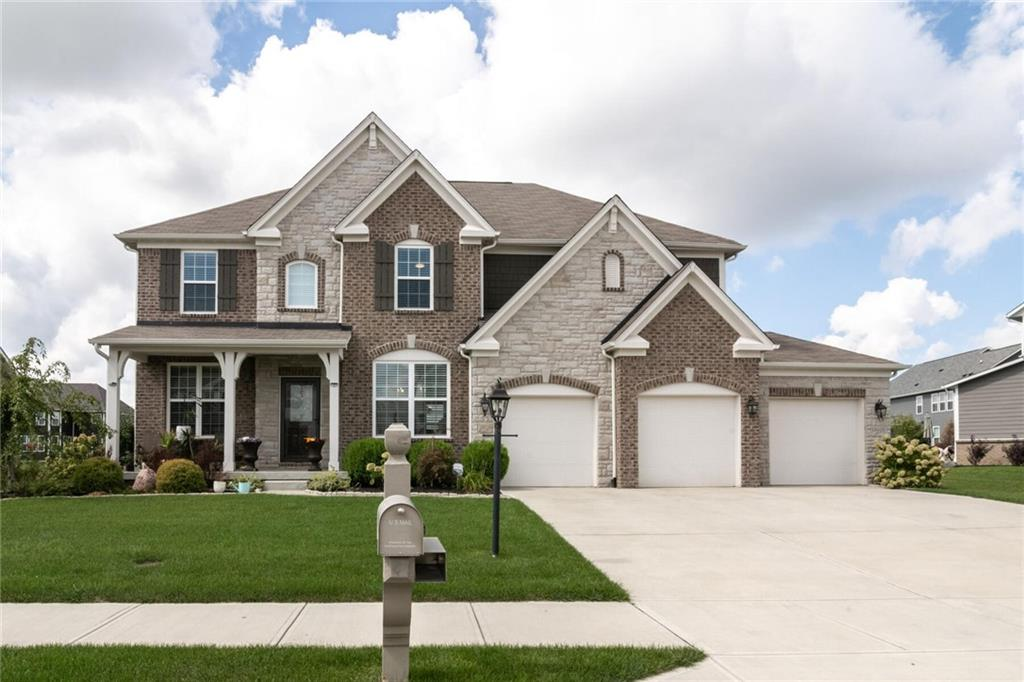 Wow! Come see this stunning newly built 4br/3.5ba home w/fully finished basement in the Belmont Place neighborhood of Fishers! Features include an open floorplan w/soaring light-filled 2-story great room w/floor-to-ceiling stacked stone fireplace, gorgeous open contemporary kitchen w/island, double oven, gas cooktop, and stone countertops, main level office, formal dining room, master bedroom w/luxurious en-suite bath that has a large walk-in closet, dual vanities, large garden tub, and oversized tiled shower, fully finished basement w/custom wet bar, full bath, and theater and gym/flex areas, attached 3 car garage, and more! Still under builders warranty! Wonderful neighborhood amenities including a park, playground, pool, trails, etc.