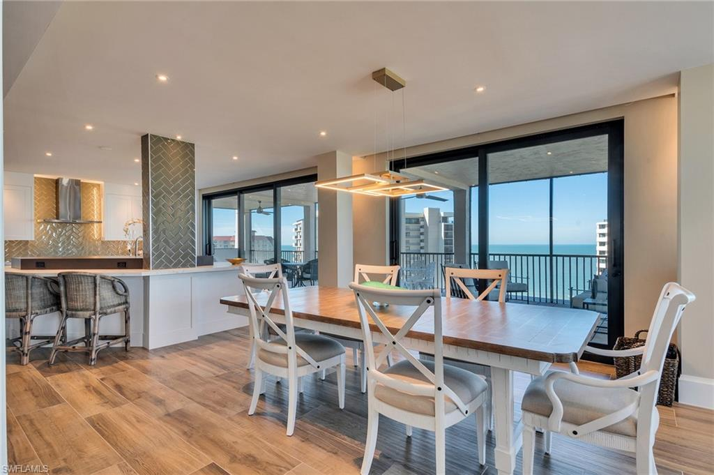 4 month minimum.  Owner strongly prefers 5-6 month lease. A one-of-a-kind, extensively renovated Penthouse unit that encompasses the entire top floor offering sweeping vistas up and down the crescent coast with dramatic Gulf and Bay Views.  This 3 bedroom, 3 bath condominium unit has a total square footage of 3,885 including outdoor space and must be seen to be appreciated.  You will have some of the best views in Vanderbilt Beach with its 42' Western facing balcony and wraparound deck.  Renovations completely reimagine this unit with an open floor-plan and new kitchen, giving it a finish and feature quality to match the breathtaking vistas, including wood tile flooring throughout, electric blinds, custom lighting, updated baths, gourmet kitchen & more! Luxury amenities abound and entail a first floor private cabana, two covered parking spaces, private beach access, tennis courts, pickle ball courts, tiki bar with grills, large community pool that overlooks Wiggins Pass Waterway & boat docks with Gulf access.  This condominium unit represents the pinnacle of Naples living with the beach on one side, the bay on the other, and world-famous shopping and dining with close proximity to Waterside Shops, The Mercato and the Naples Philharmonic.