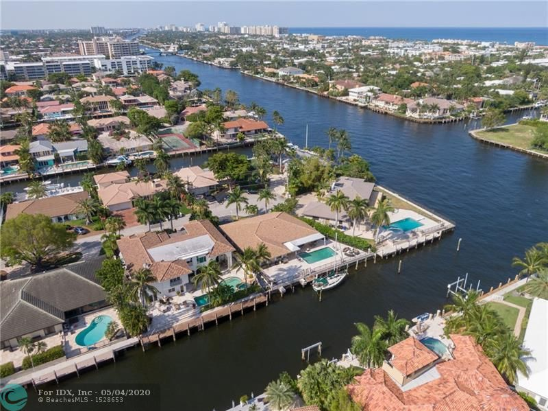 LOCATION-LOCATION-LOCATION -- Unlimited Potential with waterfront views just one lot off the Intracoastal.  Located on one of the finest Isles in Coral Ridge Country Club, this 105 ft Waterfront Home boast SE Exposure and is perfect for entertaining Family & Friends. This residence with its Grand Open Concept, Newer Roof,  Outdoor Space,  and split 4 bedroom floor plan is ready to be customized into your Dream Home.  Views cannot be duplicated!! Motivated Seller--Furniture Negotiable--Back on Market with a $300k Price reduction from a year ago.