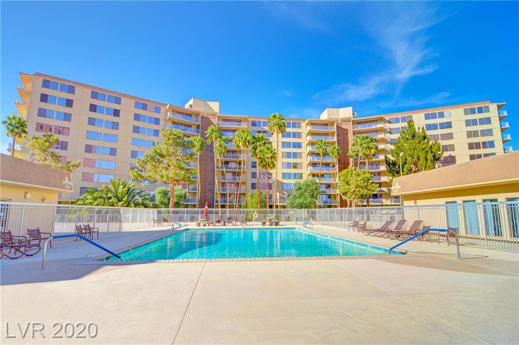 Amazing Vegas strip-side location! spacious corner unit. Under 10min walk to center of LV strip & close to Raiders stadium. Tile floors throughout. Upgraded kitchen & custom baths. Granite & s/steel. Strip & mountain views & huge balcony w/ kitchen access. Secure 24/7 guard & cameras. pool, spa, sauna, gym, clubhouse, bbq area, tennis courts, basketball area, etc. Building remodel almost complete. u/ground secure parking. avail. fully furnished