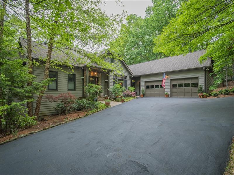Level circular driveway. Welcoming main entry foyer. LR has native-stone, gas-logged FP & bookcases. Dining rm with a wet bar. Kitchen with a large island, prep sink, Dacor gas cooktop, & pantry. Kitchen has a gathering area & screened porch access to grilling area, & garden deck. Laundry/mud room with sink.  Master BR has access to screen porch. The master bath with 2 walk-in closets, shower & Jacuzzi tub. Lower level 2 BRs, bath plus an office/day-room, covered porch & potting room, mechanical rm. New roof. Oversized 2-car garage built-in stairway to a storage attic.